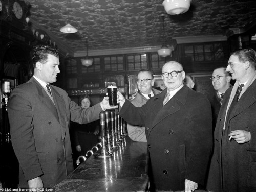 Leslie Compton serves Tom Whittaker a pint in 1956 at Hanley Arms